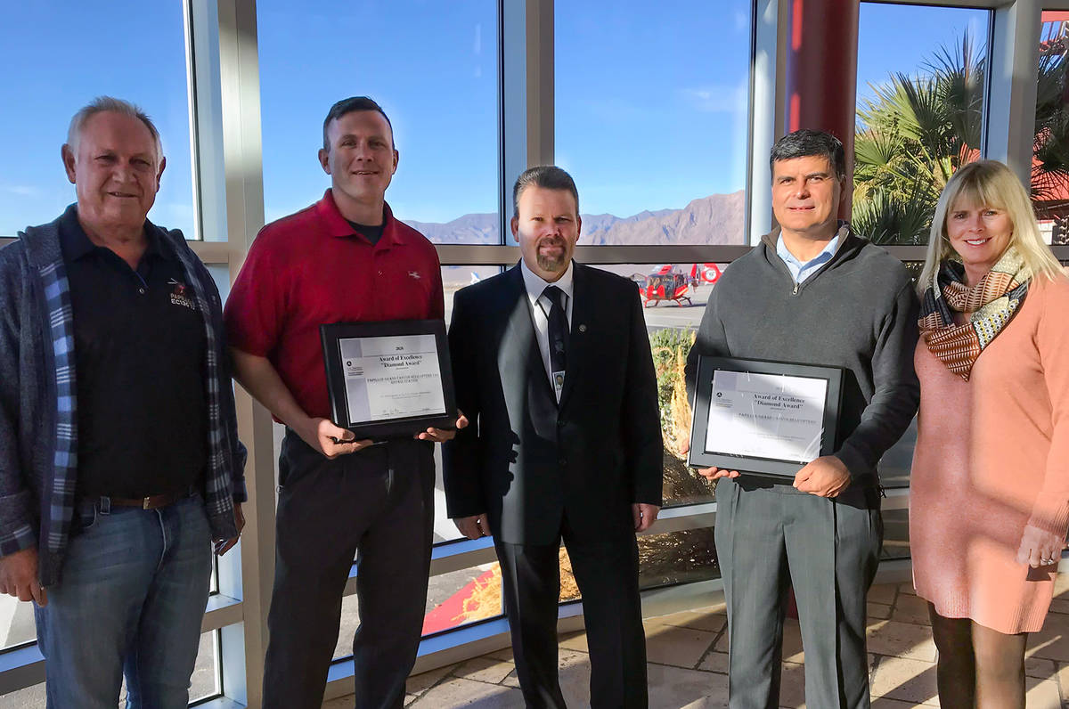(Papillon Grand Canyon Helicopters) Papillon Grand Canyon Helicopters staff, from left, Lon Hal ...
