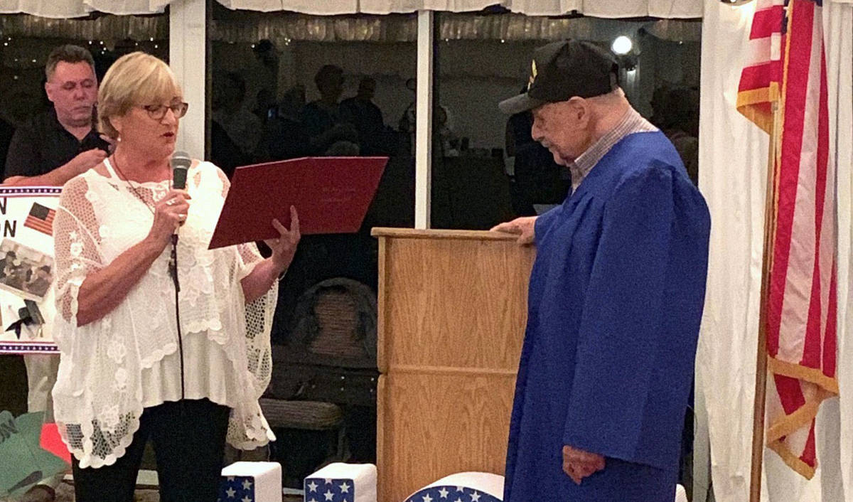 Boulder City resident Charm McElree, seen in 2019 presenting a high school diploma to 96-year-o ...