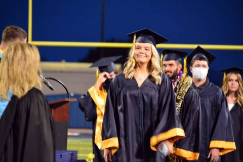 Celia Shortt Goodyear/Boulder City Review Emmaleigh Compton walks across the stage to receive h ...