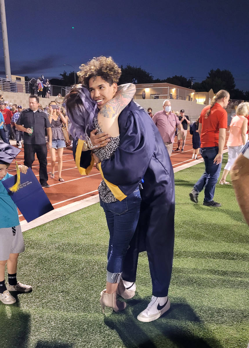 Celia Shortt Goodyear/Boulder City Review Class of 2021 graduate Thaine Canepa-Stills hugs his ...