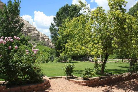 (Deborah Wall) Mature perennial gardens and lush vegetation are made possible by the nine natur ...