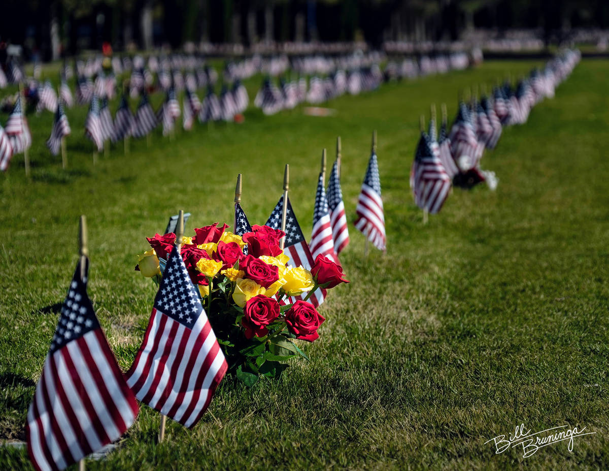 (Bill Bruninga/Special to the Boulder City Review) Flowers and flags adorn the gravesites of ve ...