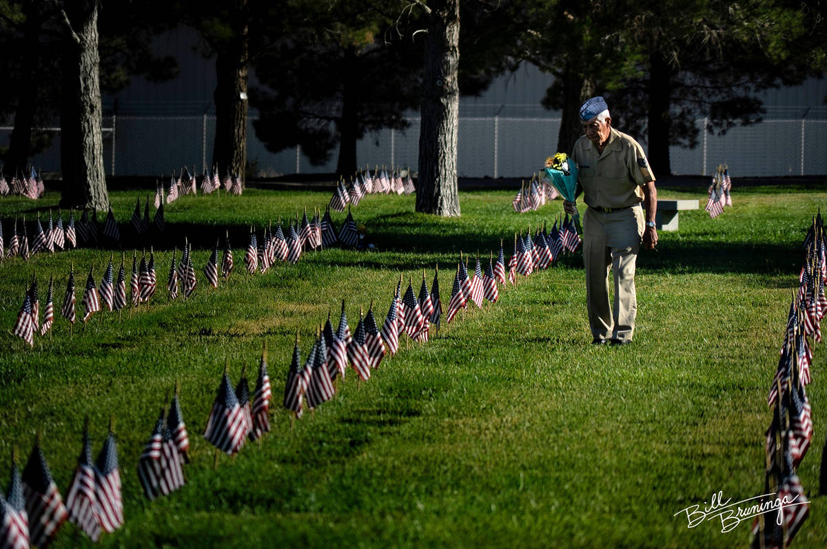 (Bill Bruninga/Special to the Boulder City Review) A retired veteran pays tribute to family mem ...