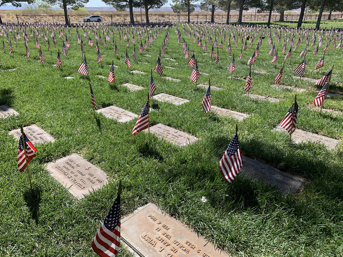(Hali Bernstein Saylor/Boulder City Review) Flags placed at every gravesite wave in the breeze ...