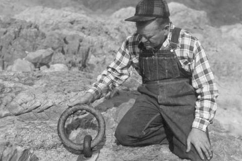(Lake Mead National Recreation Area) Murl Emory is shown with one of the ring bolts at the Ring ...