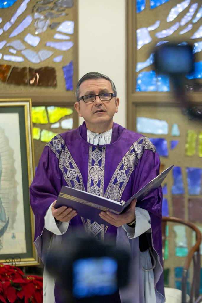 (Ellen Schmidt/Las Vegas Review-Journal) Msgr. Gregory Gordon, seen celebrating a virtual Mass ...
