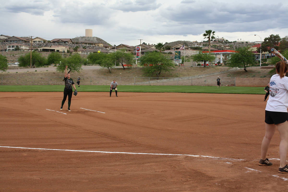 (Kelly Lehr) Kelli Greene from Boulder Dam Credit Union pitches during the coed softball leagu ...
