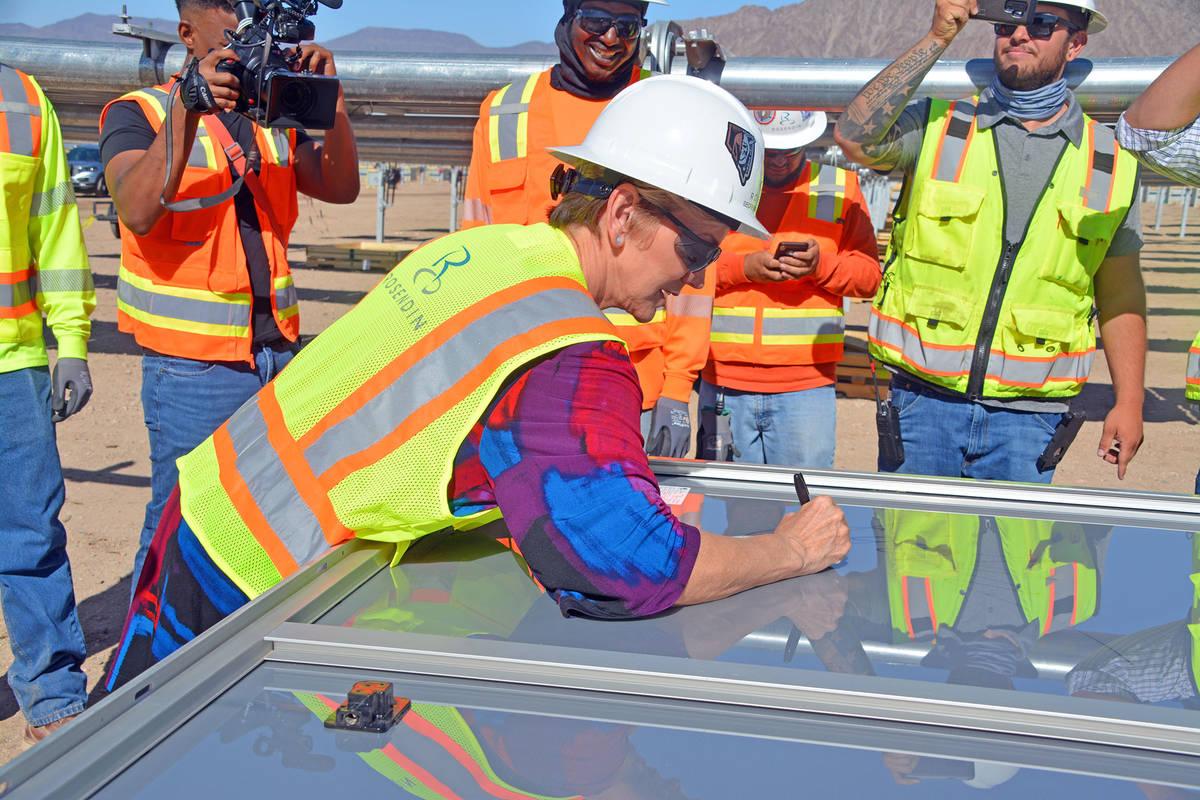 Celia Shortt Goodyear/Boulder City Review U.S. Secretary of Energy Jennifer Granholm signs a so ...