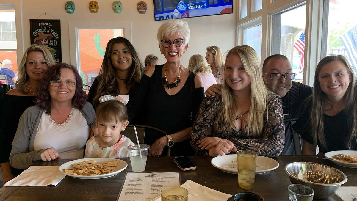 (Hali Bernstein Saylor/Boulder City Review) Cokie Booth, center, met with family and friends at ...