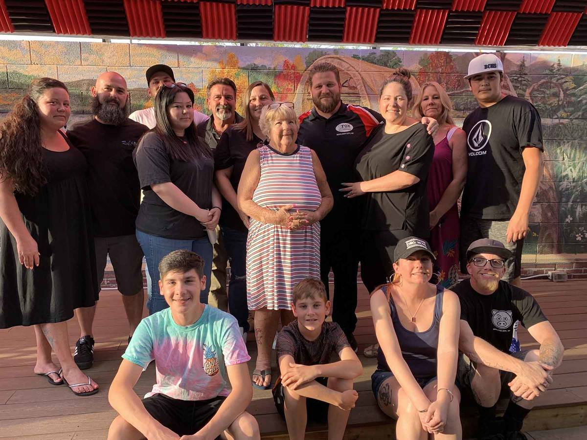 (Hali Bernstein Saylor/Boulder City Review) Mathew Fox, fourth from right in back, gathered wit ...