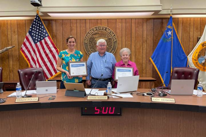 Boulder City Outgoing Councilwomen Tracy Folda, left, and Judy Hoskins, right, were recognized ...