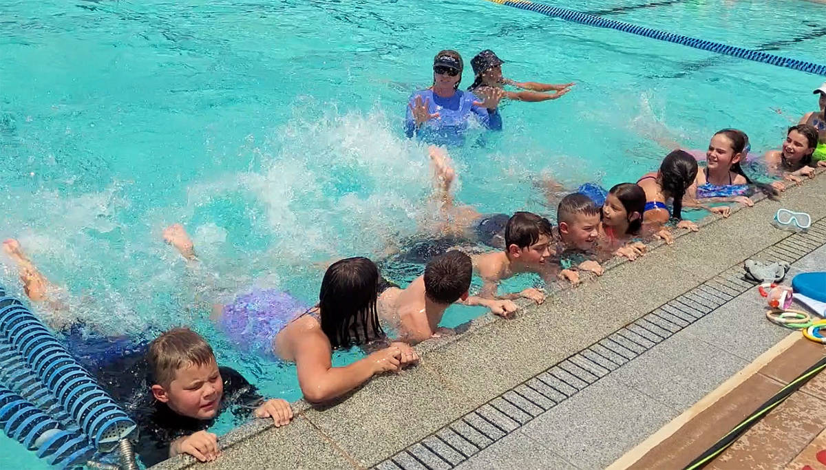 Celia Shortt Goodyear/Boulder City Review Swim instructor Colleen Fay takes participants throug ...