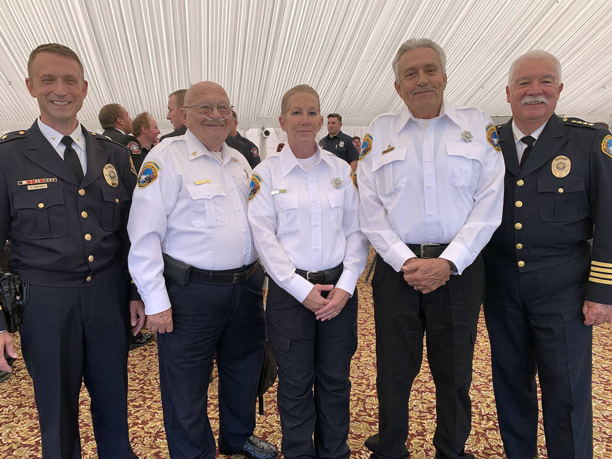 (Hali Bernstein Saylor/Boulder City Review) Boulder City Police Department volunteers, in white ...