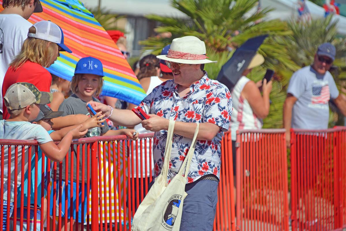 Celia Shortt Goodyear/Boulder City Review Councilman James Howard Adams hands out personal fans ...