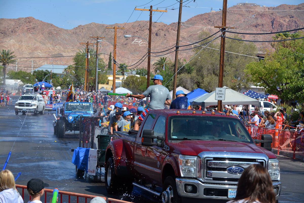 Celia Shortt Goodyear/Boulder City Review People on the water play parade entries soak the crow ...