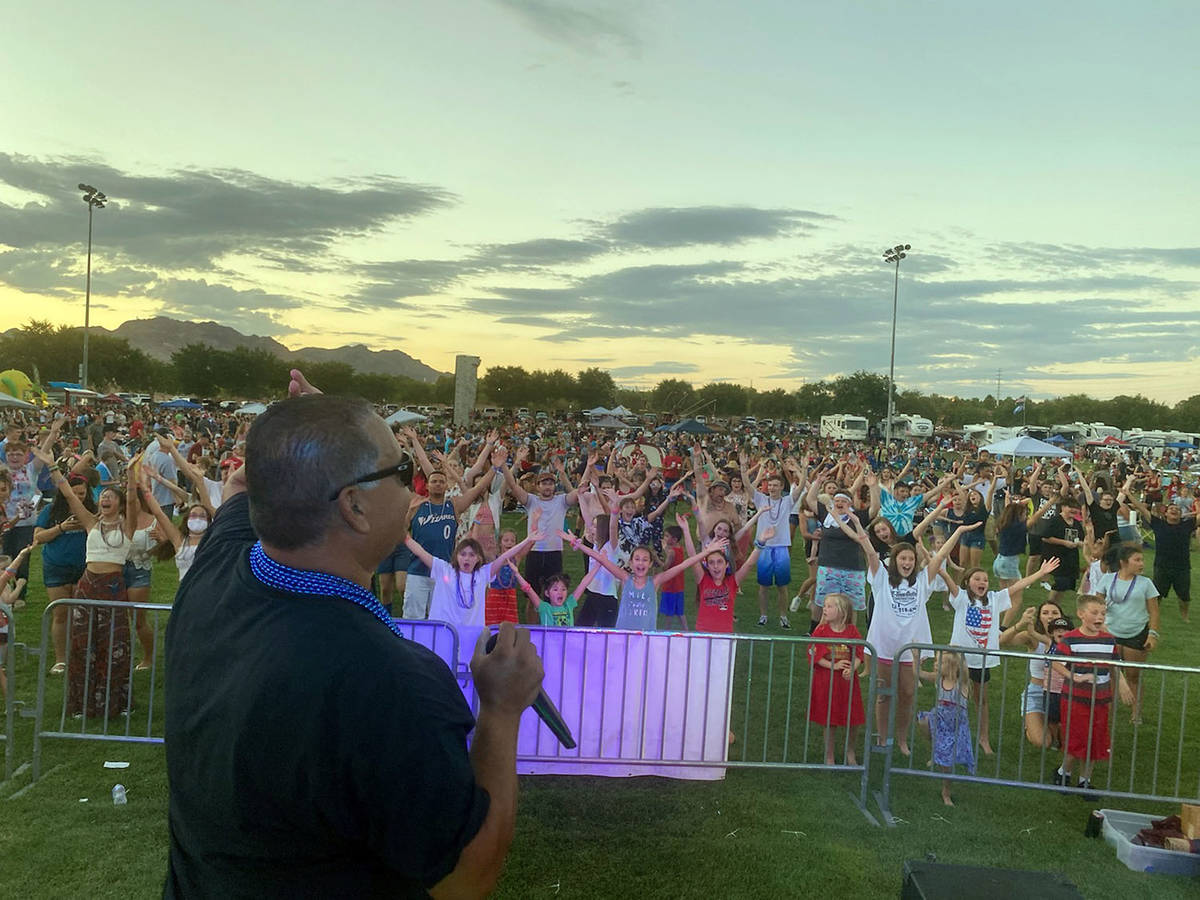 Morgan Pacini DJ Mike Pacini gets the crowd fired up at Veterans' Memorial Park on Sunday, July ...