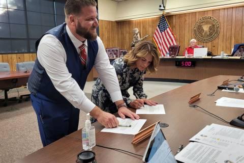 Celia Shortt Goodyear/Boulder City Review New councilmembers Matt Fox and Sherri Jorgensen sign ...