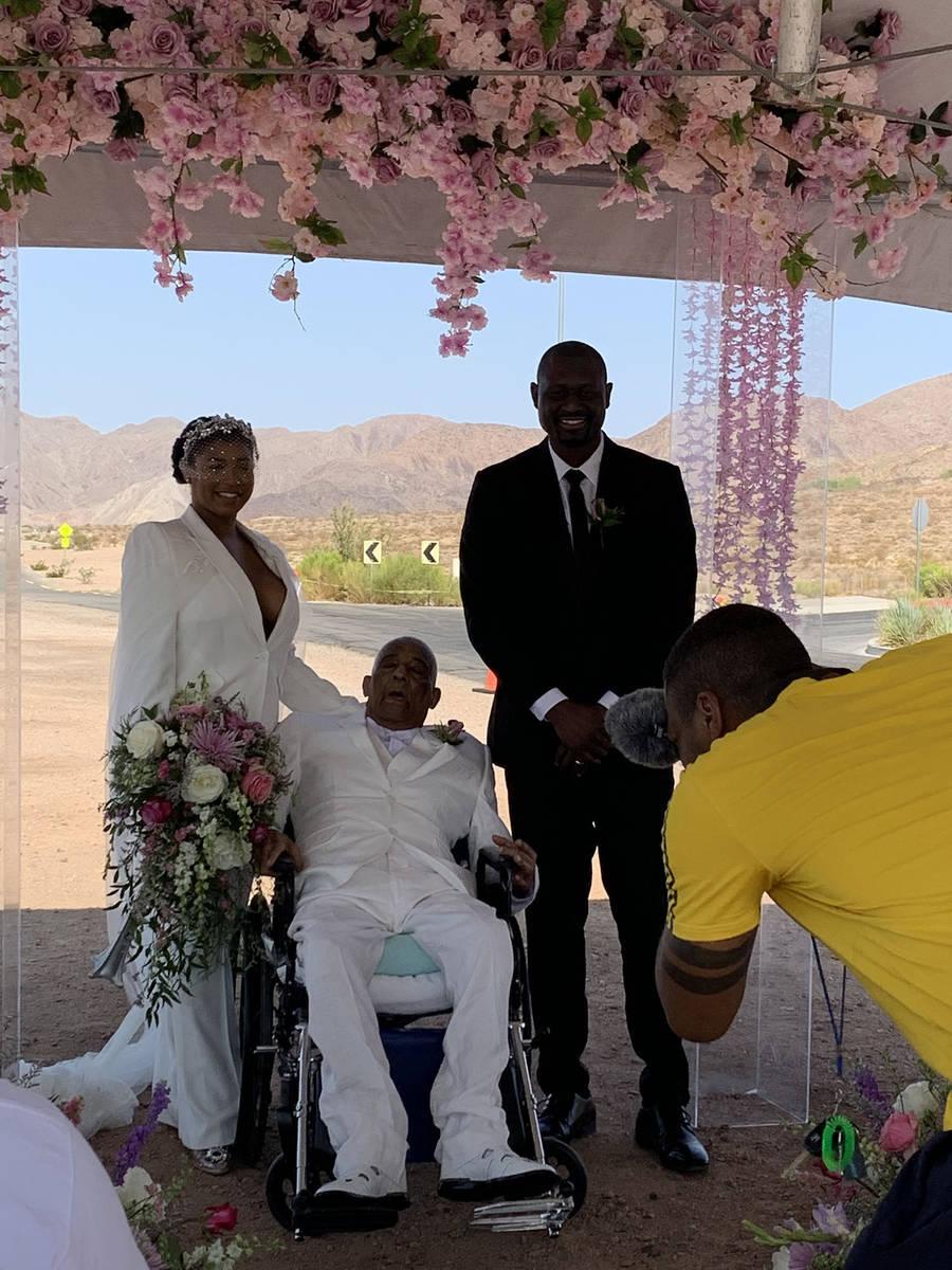 (Hali Bernstein Saylor/Boulder City Review) Newlyweds Arabia Umrani and Marius Chawa pose for a ...