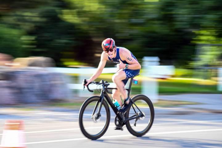 Eduardo Miler Cruising down the bike path, Ethan Porter glides down the lane at the Wasatch tri ...