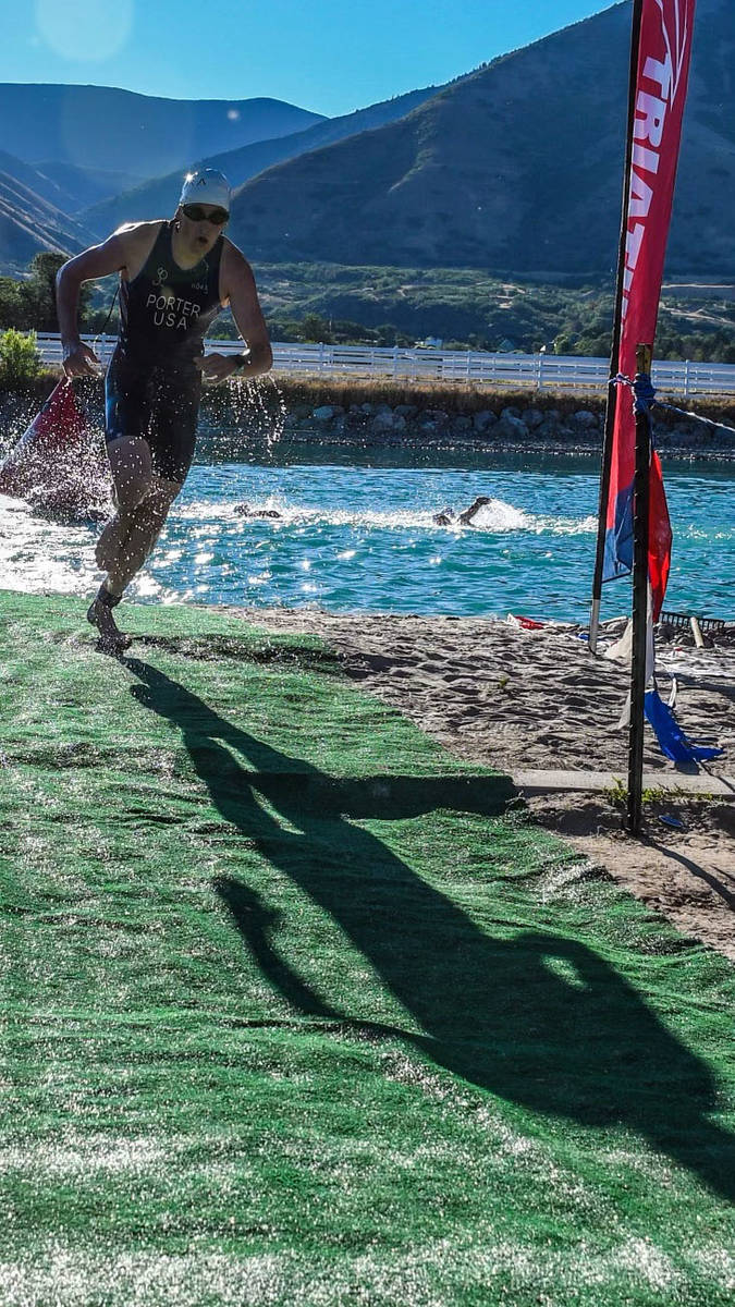 Paul Clawson Ethan Porter escapes the water to head to his next event at the Wasatch triathlon ...
