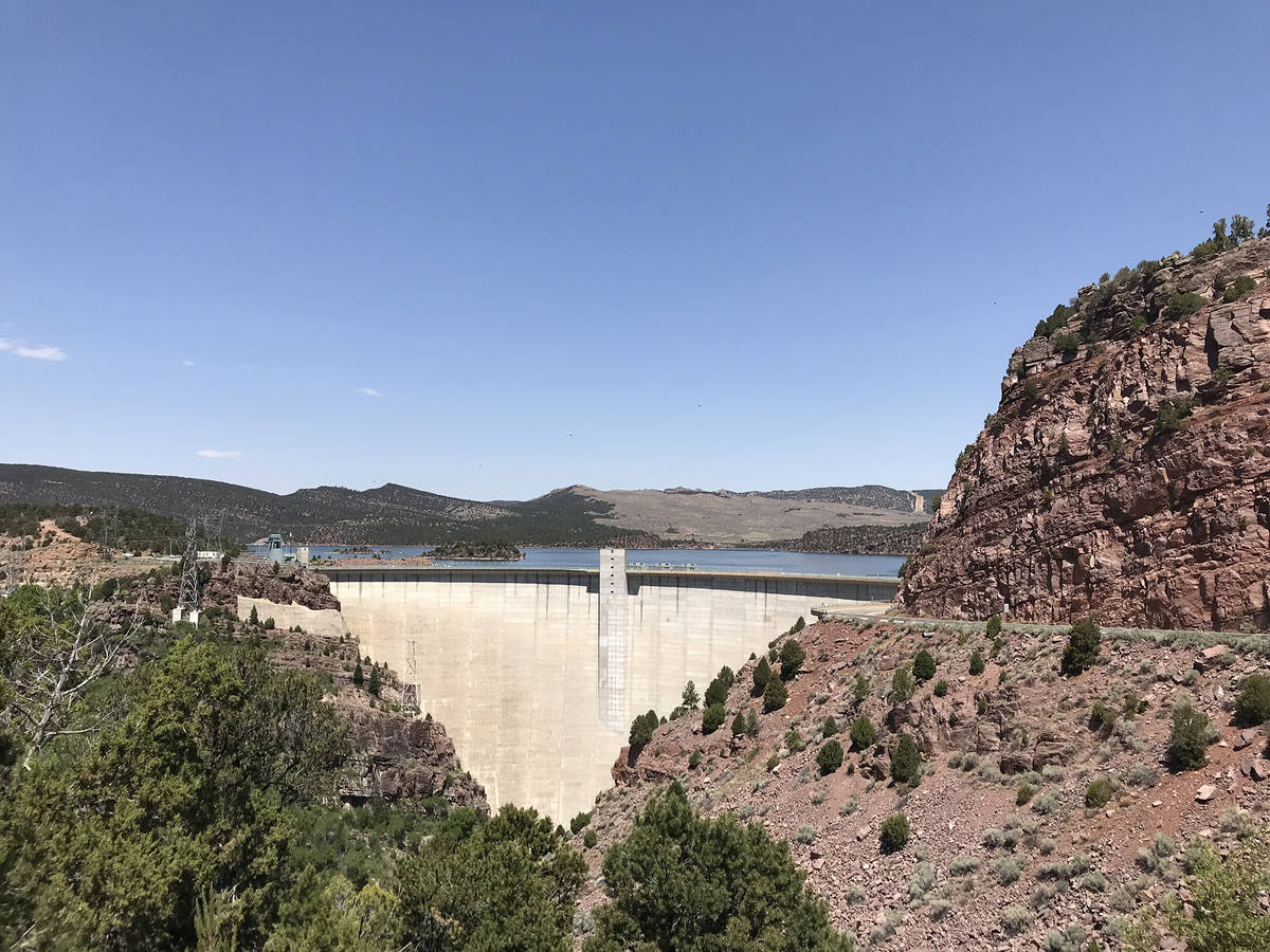 (Deborah Wall) The Flaming Gorge Dam, completed in 1964, impounded the Green River and created ...