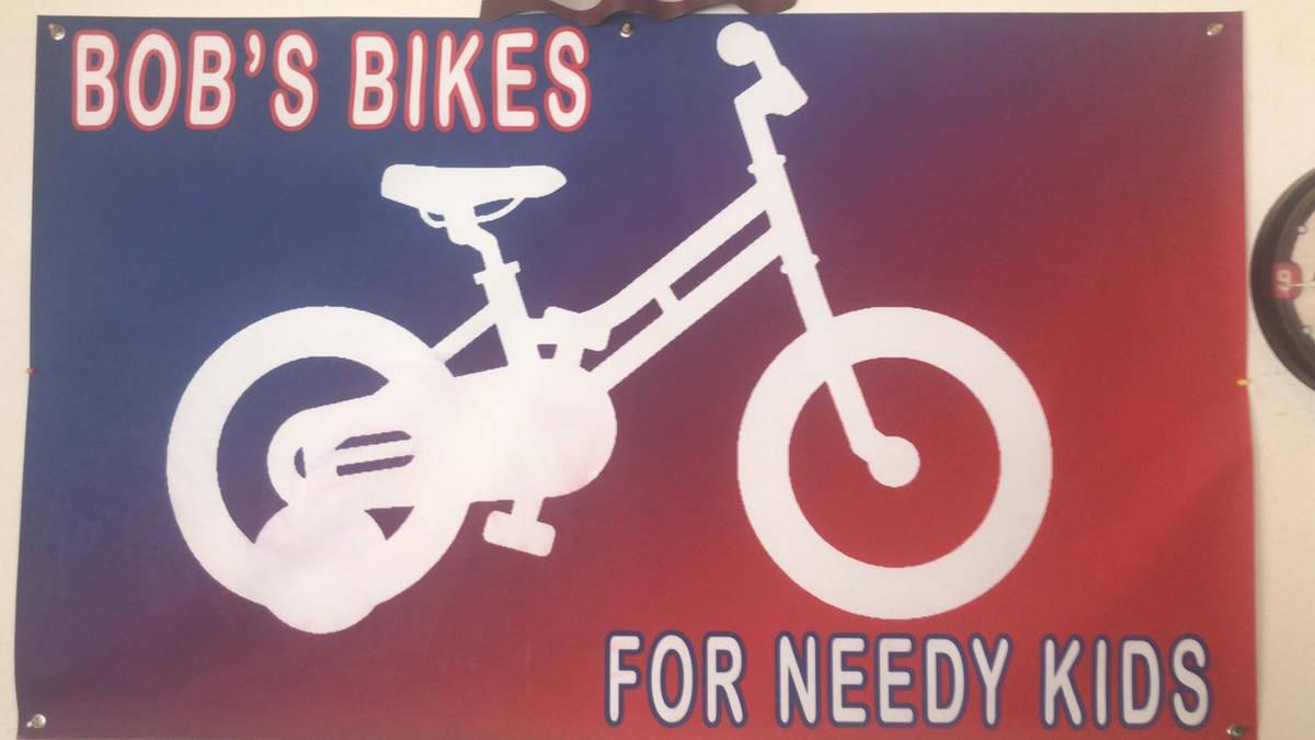 (Bob's Bikes for Needy Kids) Bob Crane, who restores and donates old bicycles ot childre ...