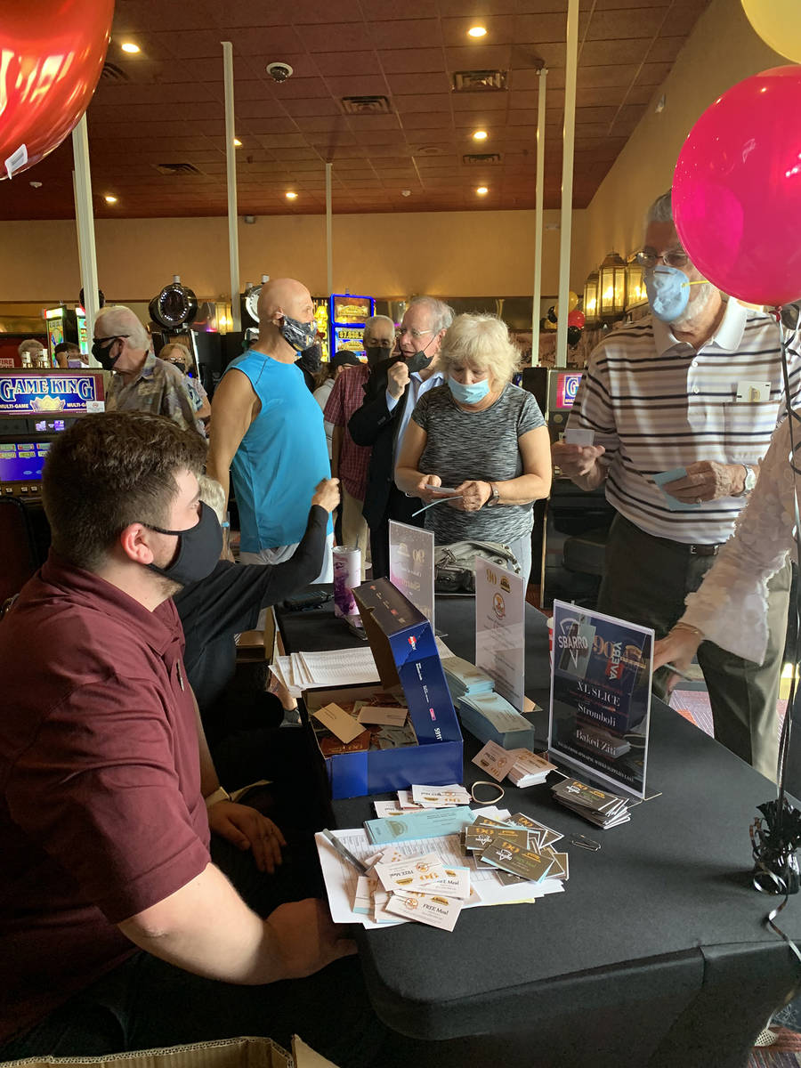 (Hali Bernstein Saylor/Boulder City Review) Staff members at the Railroad Pass check in guests ...