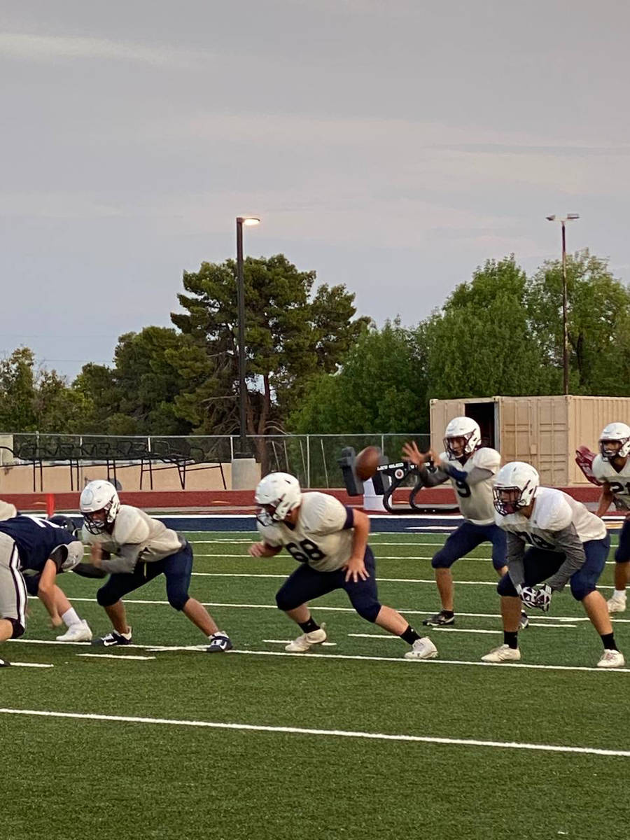 (Amy Wagner) Members of the Eagles varsity football team get some practice in during a scrimmag ...