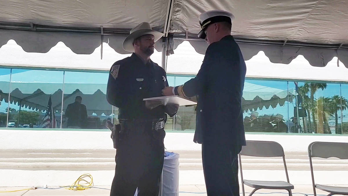 Celia Shortt Goodyear/Boulder City Review U.S. Coast Guard Rear Adm. Brian Penoyer pins the Sil ...