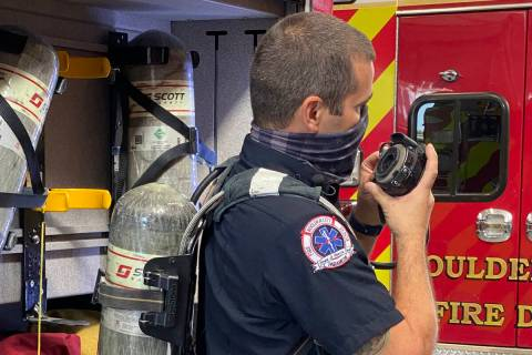 Boulder City Boulder City firefighter Jay Dardano shows off one of the current airpacks used by ...