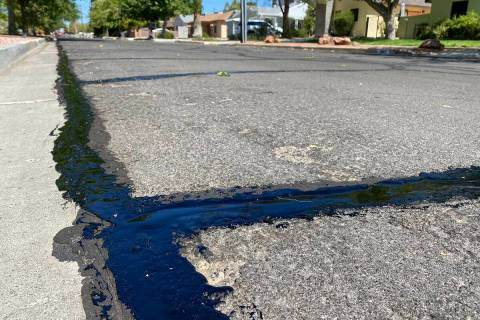 (Norma Vally/Boulder City Review) Sealing and repairing major cracks in the city's roads can ...