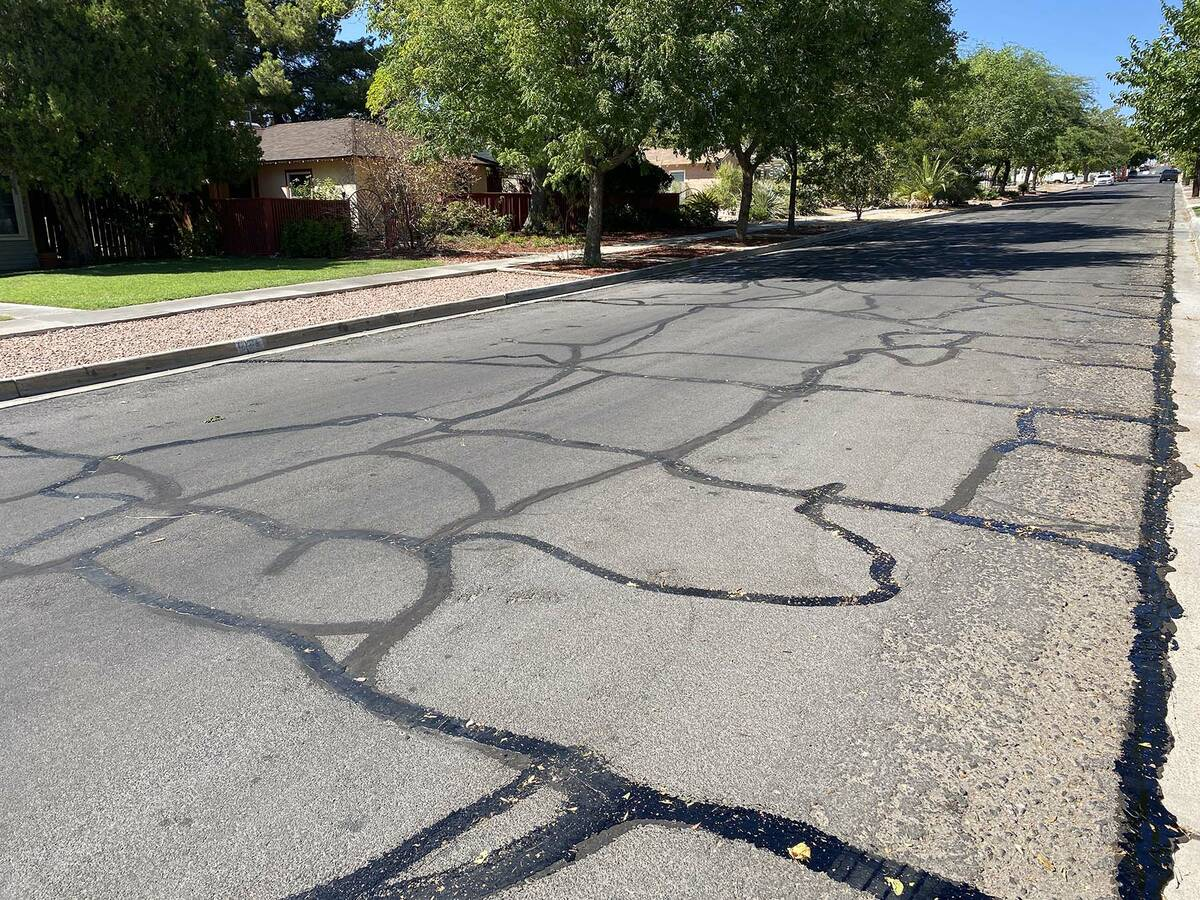 (Norma Vally/Boulder City Review) Sealing cracks on city streets will help prevent major damage ...