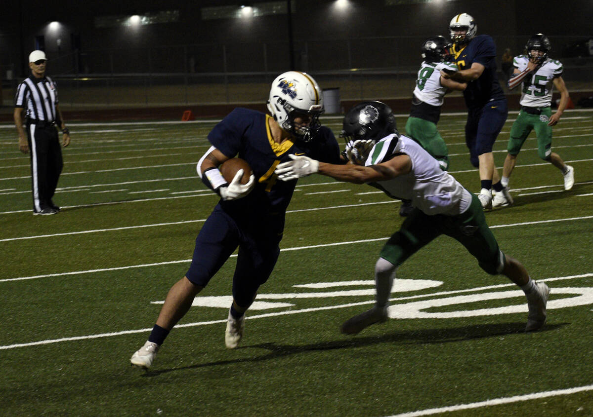 (Pernell Bryant/Boulder City Review) Boulder City High School junior Torryn Pinkard carries th ...