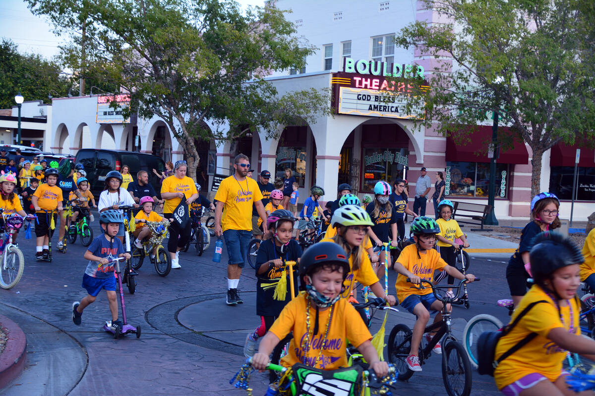 Celia Shortt Goodyear/Boulder City Review Students from King Elementary School ride their bikes ...