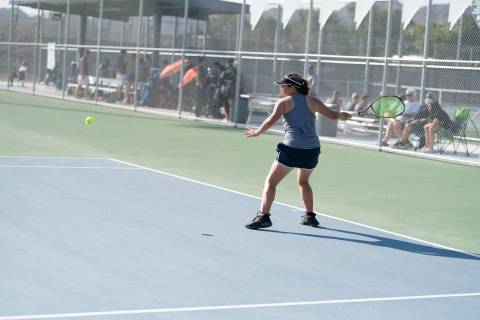 (Jamie Jane/Boulder City Review) Boulder City High School sophomore Lilly Mikkelson hits the ba ...