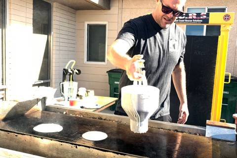 (Hali Bernstein Saylor/Boulder City Review) Firefighter Brandon Featherly makes pancakes for th ...