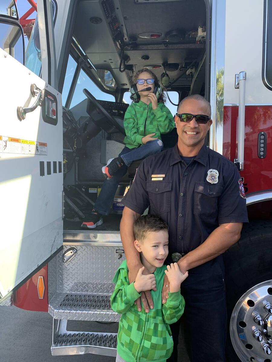 (Hali Bernstein Saylor/Boulder City Review) Boulder City firefighter Harold Hadley shows his so ...