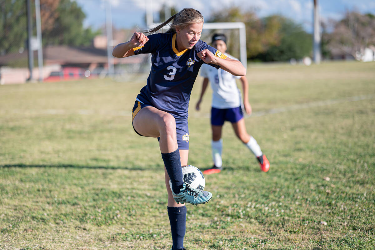 (Jamie Jane/Boulder City Review) Senior Samantha Bahde goes after the ball Friday, Oct. 8, as t ...